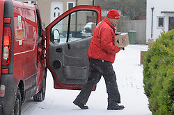 © Licensed to London News Pictures. 18/01/2013.A postman delivering in the snow..Snow fall in the borough of Bromley, South East London over night..Snow in Bromley and across the UK today (18.01.13) as  temperatures stay low..Photo credit : Grant Falvey/LNP