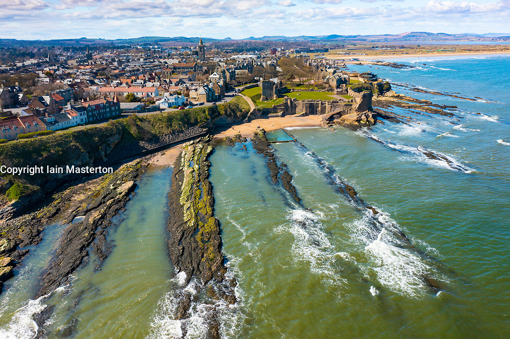 Aerial view from drone of St Andrews town and St Andrews Castle, Fife, Scotland, UK and