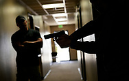 """DENVER, CO - MARCH 24: Joe Deedon, former law enforecement officer and owner of Tac*One Consulting (L), coaches a student (R) in Deedon's """"Lone Wolf"""" civilian active shooter response course for concealed weapons permit holders on March 24, 2018 in Longmont, Colorado. The class, based on a similar law enforcement course, is designed to challenge students mentally and physically leaving with a solid plan to defend themselves and others during the critical first moments of a deadly attack. (Photo by Rick T. Wilking/Getty Images)"""