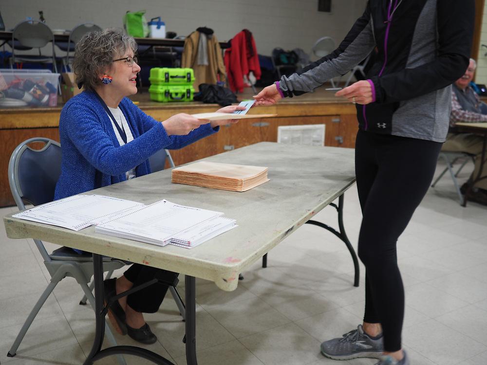 A Virginia voter receives her ballot.