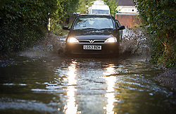 © London News Pictures. 17/10/2012. Hatfield, UK. A car driving through flood water on a road near the town of Hatfield. Hertfordshire, UK on October 17, 2012 following heavy rain last night . Photo credit : Ben Cawthra /LNP