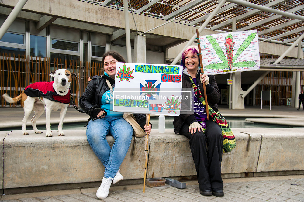 Pictured: Honey (10) Nicole Dickson (25) and her mother Marianne Dickson (42) whose placard is covered on both sides by the many diseases helped by medicianal cannabis picked up from the FaceBook page CBDusersuk@facebook<br /> Protesters gathered outside the Scottish Parliament while they waited on colleagues in meeting with MSPs and health car professionals who were putting forward the case to legalise medicinal cannabis.  Most had first hand experience of the benefits of using the drug under medical supervision.<br /> <br /> <br /> Ger Harley   EEm Date