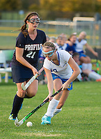 Gilford's Logan Baxter takes control of the ball against Profile's #21-Brown during NHIAA Division III Field Hockey on Friday afternoon.  (Karen Bobotas/for the Laconia Daily Sun)