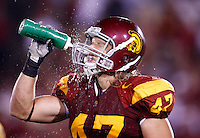 1 September 2007: #47 Clay Matthews cools off splashing water bottle on himself during  USC Trojans college football team defeated the Idaho Vandals 38-10 at the Los Angeles Memorial Coliseum in CA.  NCAA Pac-10 #1 ranked team first game of the season.