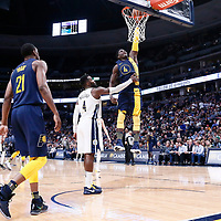 03 April 2018: Indiana Pacers guard Victor Oladipo (4) goes for the dunk after a foul called during the Denver Nuggets 107-104 victory over the Indiana Pacers, at the Pepsi Center, Denver, Colorado, USA.