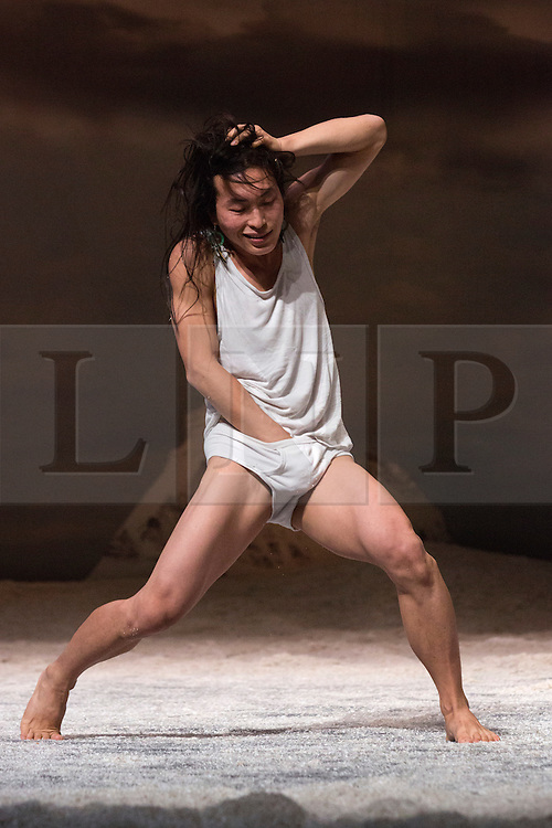 "© Licensed to London News Pictures. 27/01/2015. London, England. Pictured: Hun-Mok Jung performing. Belgian dance collective Peeping Tom presents their piece ""32 rue Vandenbranden"" at the Barbican Theatre in association with London International Mime Festival (LIMF) from 28 to 31 January 2015. Show was conceived and directed by Gabriela Carrizo and Franck Chartier with Seoljin Kim, Hun-Mok Jung, Marie Gyselbrecht, Jos Baker, Maria Carolina Vieira and Euridike De Beul performing. Photo credit: Bettina Strenske/LNP"