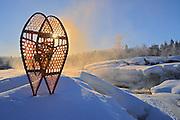 Snowshoes by Pinawa River at sunrise <br /> Pinawa<br /> Manitoba<br /> Canada