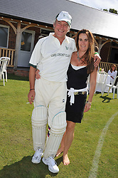 NICK & DOTTY FRASER at a cricket match to in aid of CARE - Corfu Animal Rescue Establishment held at Hawkley Cricket Club, Hawkley, Hampshire on 8th September 2012.
