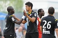 FOOTBALL - FRIENDLY GAMES 2010/2011 - STADE BRESTOIS v LILLE OSC - 31/07/2010 - PHOTO PASCAL ALLEE / DPPI - JOY MOUSSA SOW (LILLE) AFTER HIS GOAL, HE IS CONGRATULATED BY TULIO DE MELO