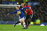 Tom Davies of Everton shields the ball from Paul Pogba of Manchester United. Premier league match, Everton v Manchester Utd at Goodison Park in Liverpool, Merseyside on New Years Day, Monday 1st January 2018.<br /> pic by Chris Stading, Andrew Orchard sports photography.