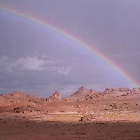 ARGENTINA. Rainbow over arid hills of the Altiplano.