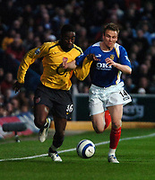 Photo: Ed Godden.<br /> Portsmouth v Arsenal. The Barclays Premiership. 12/04/2006. Johan Djourou (L) and Pompeys Matthew Taylor.