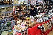 Woman shopkeeper standing in her souvenir gift shop, Plovdiv, Bulgaria, eastern Europe