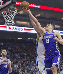 December 31, 2017 - Sacramento, CA, USA - The Sacramento Kings' Bogdan Bogdanovic (8) goes to the basket against the Memphis Grizzlies on Sunday, Dec. 31, 2017, at the Golden 1 Center in Sacramento, Calif. (Credit Image: © Hector Amezcua/TNS via ZUMA Wire)