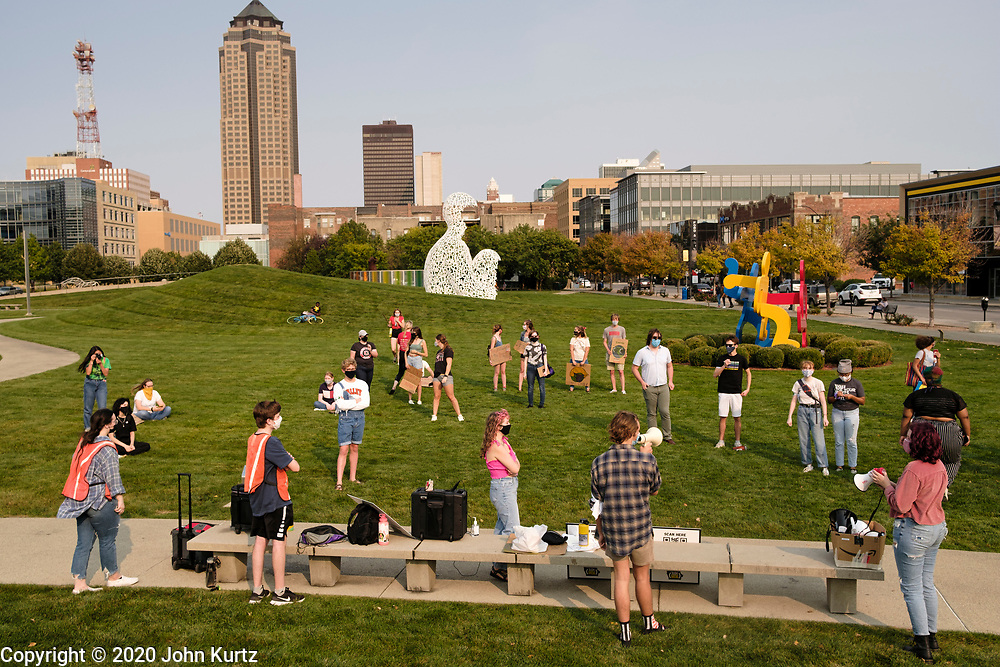 25 SEPTEMBER 2020 - DES MOINES, IOWA: About 25 high school students from the Des Moines area gathered in the John and Mary Pappajohn Sculpture Park in downtown Des Moines Friday evening for the Global Day of Climate Action. They called on policy makers and elected officials to implement climate friendly policies. They also called for racial justice and support for the Black Lives Matter movement.   PHOTO BY JACK KURTZ