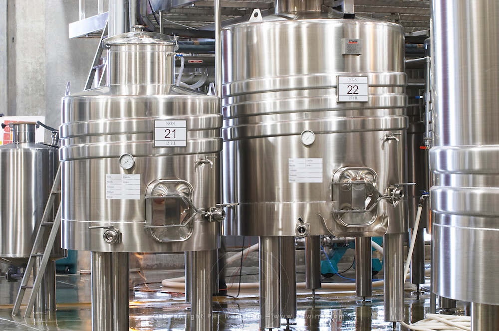 View over the winery, stainless steel fermentation tanks. small tanks of varying sizes Bodega NQN Winery, Vinedos de la Patagonia, Neuquen, Patagonia, Argentina, South America