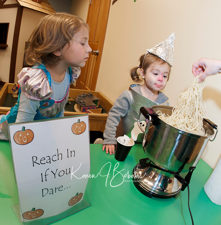 """""""Fairy Princess"""" Peyton Gregoire and the """"Tin Man"""" Amelia Morel are still deciding whether or not to take the dare at Gilford Library's annual Halloween Parade and Party on Wednesday morning.  (Karen Bobotas/for the Laconia Daily Sun)"""