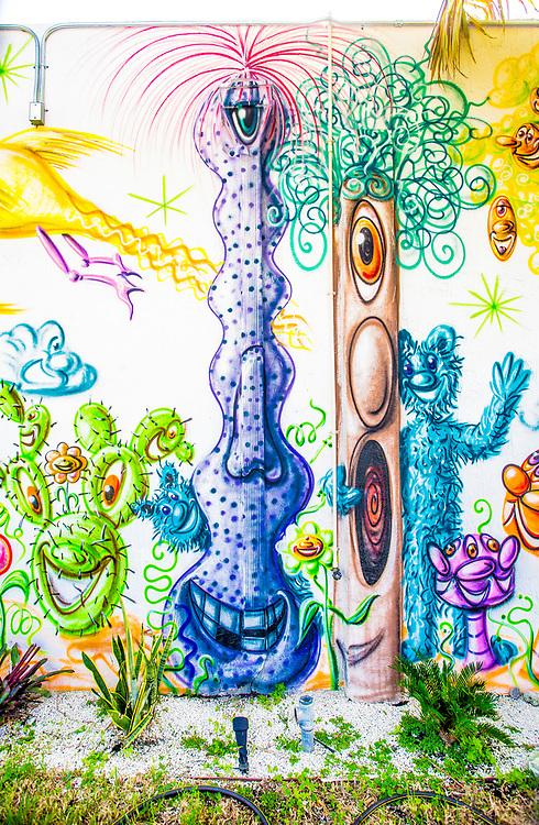 Detail of an outdoor mural by pop-artist Kenny Scharf in a garden in Miami's Wynwood district.