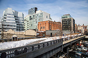 A view of the pedestrian High Line walkway over 10th Avenue; Chelsea; New York City; New York, United States of America.  The iconic InterAtiveCorp building is in the background.