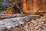 Virgin River Narrows, Zion NP, Utah.  I have come up through the deep part below, around the second bend, equipment in day pack and daypack above head as the water deepened to my armpits.  Each foot step a hope that there was still streambed vs a void.   The rock has broken off from somewhere high above on the hard place, and the hard place is immovable.  But the water must flow, and so it compromises a way between a rock and a hard place.   I have been here before, navigating a course in the current, feeling like any decision I make would be the wrong one.  And they were...so many were.  Standing here, beyond my latest,  I look back on a river of regrets.