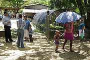 A woman leaves with her daughter after attending a vaccination session at the primary school in the town of Coyolito, Honduras on Wednesday April 24, 2013.