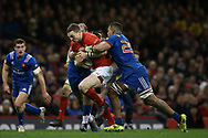 George North of Wales runs at Mathieu Bastareaud (l) and Mathieu Babillot of France ®. Wales v France, NatWest 6 nations 2018 championship match at the Principality Stadium in Cardiff , South Wales on Saturday 17th March 2018.<br /> pic by Andrew Orchard, Andrew Orchard sports photography