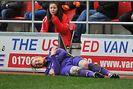 Simon Makienok of Charlton Athletic injured after falling over the advertising boards  during the Sky Bet Championship match between Rotherham United and Charlton Athletic at the New York Stadium, Rotherham, England on 30 January 2016. Photo by Ian Lyall.