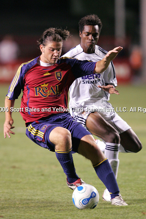 12 August 2006: Real Salt Lake's Nikolas Besagno (left) controls in front of Real Madrid's Javier Balboa (right). Real Madrid of La Liga in Spain defeated Real Salt Lake of Major League Soccer in the U.S. 2-0 at Rice-Eccles Stadium in Salt Lake City, Utah in the 2006 XanGo Cup, an international club friendly.