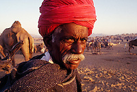 """A cameltrader at the Pushkar camelfair, Rajasthan, India. 1995<br /> Available as Fine Art Print in the following sizes:<br /> 08""""x12""""US$   100.00<br /> 10""""x15""""US$ 150.00<br /> 12""""x18""""US$ 200.00<br /> 16""""x24""""US$ 300.00<br /> 20""""x30""""US$ 500.00"""