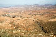 Roading running across barren interior, Valle de Santa Ines, Fuerteventura, Canary Islands, Spain