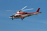Fire fighter's helicopter AgustaWestland AW109 E Power Elite (VF-84) in flight at Malpensa (MXP / LIMC), Milan, Italy