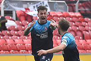 Woking forward Jake Hyde (9)  scores a goal and celebrates  0-1 during the The FA Cup 2nd round match between Swindon Town and Woking at the County Ground, Swindon, England on 2 December 2018.