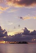 Motu (island) off Moorea at sunset<br />