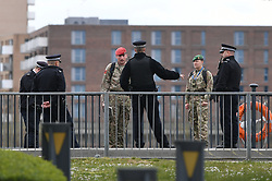 Soldiers and police at the ExCel centre in London which is being made into the temporary NHS Nightingale hospital to help tackle coronavirus.