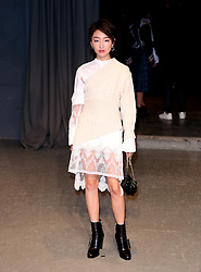 Zhou Dong Yu attending the Burberry London Fashion Week Show at Makers House, Manette Street, London.