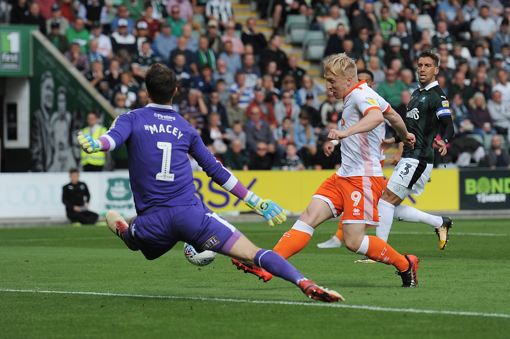 Blackpool's Mark Cullen shoots wide under pressure from Plymouth Argyle's Matt Macey<br /> <br /> Photographer Kevin Barnes/CameraSport<br /> <br /> The EFL Sky Bet League One - Plymouth Argyle v Blackpool - Saturday 15th September 2018 - Home Park - Plymouth<br /> <br /> World Copyright © 2018 CameraSport. All rights reserved. 43 Linden Ave. Countesthorpe. Leicester. England. LE8 5PG - Tel: +44 (0) 116 277 4147 - admin@camerasport.com - www.camerasport.com