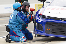 June 10, 2018 - Brooklyn, Michigan, U.S - The pit crew of NASCAR driver BUBBA WALLACE JR. (43) make repairs to the front right side of his car during the 50th Annual FireKeepers Casino 400 at Michigan International Speedway. (Credit Image: © Scott Mapes via ZUMA Wire)