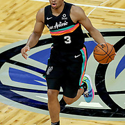ORLANDO, FL - APRIL 12: Keldon Johnson #3 of the San Antonio Spurs dribbles the ball against the Orlando Magic at Amway Center on April 12, 2021 in Orlando, Florida. NOTE TO USER: User expressly acknowledges and agrees that, by downloading and or using this photograph, User is consenting to the terms and conditions of the Getty Images License Agreement. (Photo by Alex Menendez/Getty Images)*** Local Caption *** Keldon Johnson