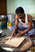 A man making sweets at Modak and Grandsons sweet shop in Chandannagar, India