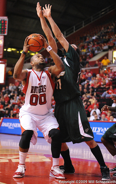 Mar 7, 2009; Piscataway, NJ, USA; Rutgers forward Gregory Echenique (00) looks for an open shot over South Florida center Alex Rivas Sanchez (11) during the first half of Rutgers' senior day game against South Florida at the Louis Brown Athletic Center.  Rutgers won 45-42.