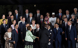 South Africa's President Cyril Ramaphosa waves as he walks past Russia's President Vladimir Putin, Japan's Prime Minister Shinzo Abe and US President Donald Trump during family photo session on the first day of the G20 summit in Osaka, Japan on June 28, 2019. Photo by Jacques Witt/Pool/ABACAPRESS.COM