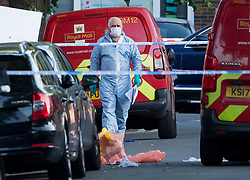 © Licensed to London News Pictures. 10/06/2021. London, UK. Police forensics at the scene In Streatham, South London where a man was stabbed to death earlier this afternoon. Photo credit: Ben Cawthra/LNP