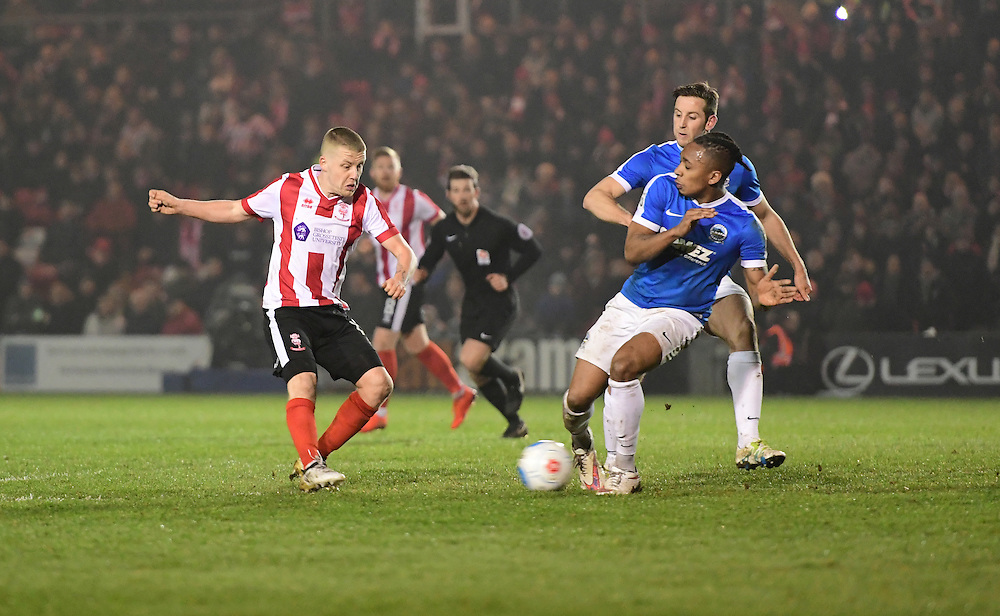 Lincoln City's Terry Hawkridge scores his sides second goal <br /> <br /> Photographer Chris Vaughan/CameraSport<br /> <br /> Vanarama National League - Lincoln City v Dover Athletic - Friday 20th January 2017 - Sincil Bank - Lincoln<br /> <br /> World Copyright © 2017 CameraSport. All rights reserved. 43 Linden Ave. Countesthorpe. Leicester. England. LE8 5PG - Tel: +44 (0) 116 277 4147 - admin@camerasport.com - www.camerasport.com