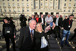 © Licensed to London News Pictures. STORMONT BELFAST - 23 JAN 2017: Sinn Fein's Michelle O'Neill and Martin McGuinness take a selfie on the steps of Stormont after being named as the politician who will take over from former deputy first minister Martin McGuinness who has retired due to illness.. Photo credit: London News Pictures.