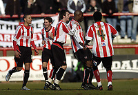 Photo: Olly Greenwood.<br />Brentford v Barnsley. Coca Cola League 1. 11/03/2006.<br />Brentford's Llyod Owusu celebrates scoring.