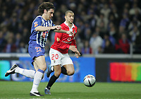 """PORTUGAL - PORTO 28 FEBRUARY 2005: GiourkasSEITARIDIS #22(L) and SIMAO SABROSA #20 compete for the ball, in the 23 leg of the Portuguese soccer league """"Super Liga"""" FC Porto (1) vs SL Benfica (1), held in """"Dragao"""" stadium  28/02/2005  20:20:47<br />(PHOTO BY: NUNO ALEGRIA/AFCD)<br /><br />PORTUGAL OUT, PARTNER COUNTRY ONLY, ARCHIVE OUT, EDITORIAL USE ONLY, CREDIT LINE IS MANDATORY AFCD-PHOTO AGENCY 2004 © ALL RIGHTS RESERVED"""