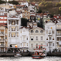 """Istanbul, Turkey 06 July 2005 <br /> Arnavutkoy (meaning """"Albanian village"""" in Turkish) is a historic neighborhood in Istanbul, famous for its wooden Ottoman houses and fish restaurants. <br /> It is part of the Beshiktas district of Istanbul, and lies on the European side of the Bosphorus.<br /> Photo: Ezequiel Scagnetti"""