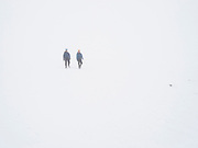 Two climbers struggle to navigate off Creag Meagaidh in a whiteout, Scottish Highlands