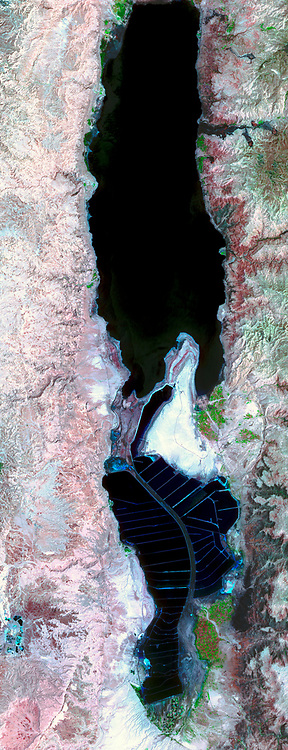 The Dead Sea is located on the border between Jordan and Israel, and is fed by the Jordan River. Satellite image. May 3, 2005