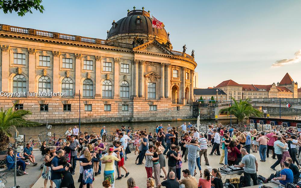 Weekend outdoor dancing in Monbijoupark beside River Spree and Bode Museum  in Mitte Berlin Germany